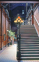 Los Angeles: Bradbury Building. Interior from Entrance. Wrought-iron stairs, brick walls. natural light. Photo '78.