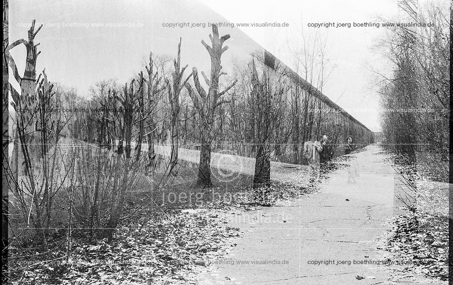 West Germany, Berlin, the wall in year 1988, double exposure with trees