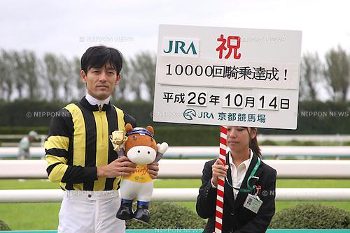 Shinichiro Akiyama,<br /> OCTOBER 14, 2014 - Horse Racing :<br /> Jockey Shinichiro Akiyama celebrates his 10000th JRA race riding after the Kyoto 1R at Kyoto Racecourse in Kyoto, Japan. (Photo by Eiichi Yamane/AFLO)