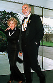 Sean Connery and his wife, Micheline Roquebrune, arrive at the White House in Washington, D.C. on December 5, 1999.  The Connerys were in Washington for Sean to receive one of the 1999 Kennedy Center honors..Credit: Ron Sachs / CNP
