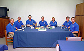 The STS-90 flight crew enjoy the traditional pre-liftoff breakfast in the crew quarters of the Operations and Checkout Building in Cape Canaveral, Florida prior to their launch on April 17, 1998 on the Neurolab mission aboard the Space Shuttle Columbia.  They are (left to right) Payload Specialist Jay Buckey, M.D., Mission Specialist Dafydd (Dave) Williams, M.D., with the Canadian Space Agency, Pilot Scott Altman, Commander Richard Searfoss, Mission Specialist Richard Linnehan, D.V.M., and Payload Specialist James Pawelczyk, Ph.D.<br /> Credit: NASA / CNP
