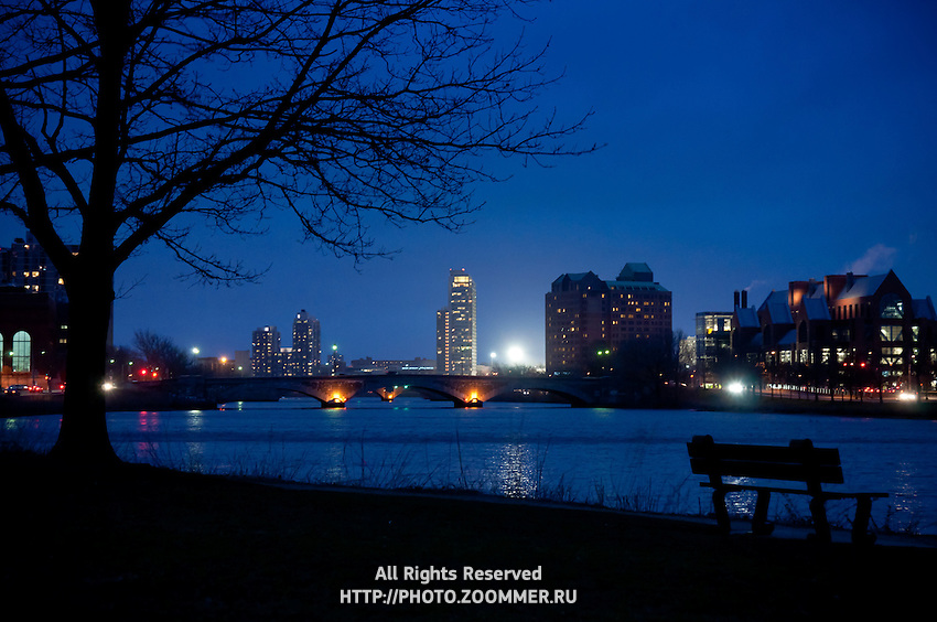 Charles river basin and park at night. Silhouette of bench and view to the Prudential