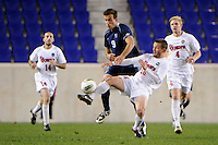 Dylan Renna (9) of the Villanova Wildcats and Adrian L'Esperance (16) of the St. John's Red Storm during the second semifinal match of the Big East Men's Soccer Championships at Red Bull Arena in Harrison, NJ, on November 11, 2011.