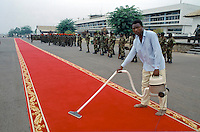 Red carpet being cleaned ready for VIP arrival in Cameroon, West Africa