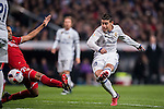 James Rodriguez of Real Madrid shoots past Gabriel Mercado of Sevilla FC to score during their Copa del Rey Round of 16 match between Real Madrid and Sevilla FC at the Santiago Bernabeu Stadium on 04 January 2017 in Madrid, Spain. Photo by Diego Gonzalez Souto / Power Sport Images