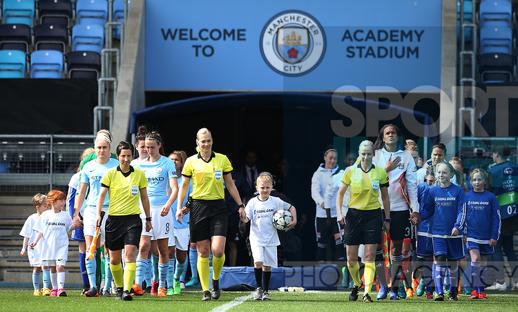 The teams walk out before kick off during the Women's Champions League, Semi Final 1st leg match at the Academy Stadium, Manchester. Picture date 22nd April 2018. Picture credit should read: Simon Bellis/Sportimage