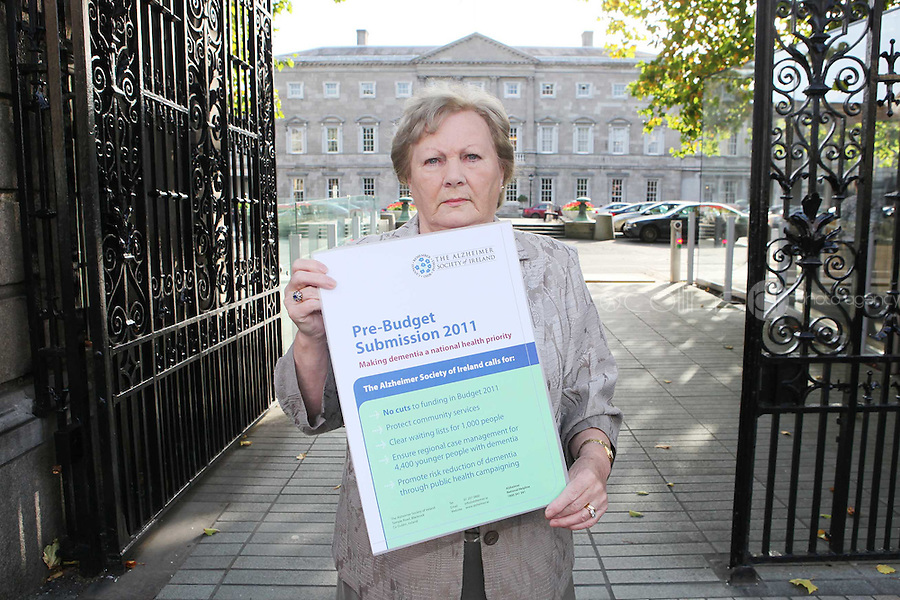 NO REPRO FEE. 7/10/2010. ALZHEIMER SOCIETY PRE-BUDGET SUBMISSION.  Carer Marjorie Dowling from Dublin who looks after her husband Christopher  took to the gates of the Dail during the launch of the charity's Pre-Budget Submission to call on the Government to help the tens of thousands of people living with dementia in Ireland and their carers. The Alzheimer Society of Ireland has warned the Government that further funding cuts to its services in the coming Budget will see some of the 44,000 people living with dementia and their 50,000 carers left without even basic support though community services. The charity made its call at the launch of its Pre-Budget Submission 2011 as it revealed that many carers are now at crisis point as figures show waiting lists for dementia services have shot up by 33% in the last year.Picture James Horan/Collins Photos