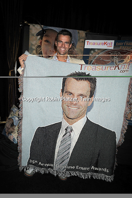 Cameron Mathison holding a TreasureKnit blanket with a photo of himself.atThe Official Talent Gift Lounge at The 35th Annual Daytime Emmy Awards backstage at The Kodak Theatre on June 19, 2008 in Hollywood, California. ..Robin Platzer, Twin Images
