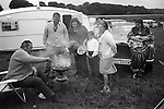A wealthy gypsy family barbecue, with Rolls Royce and caravan, Derby Day horse race,  Epsom Downs, Surrey, England 1974.<br />