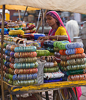 A RAJASTHANI WOMAN sells BRACELETS in JODHPUR also known as the BLUE CITY - RAJASTHAN, INDIA