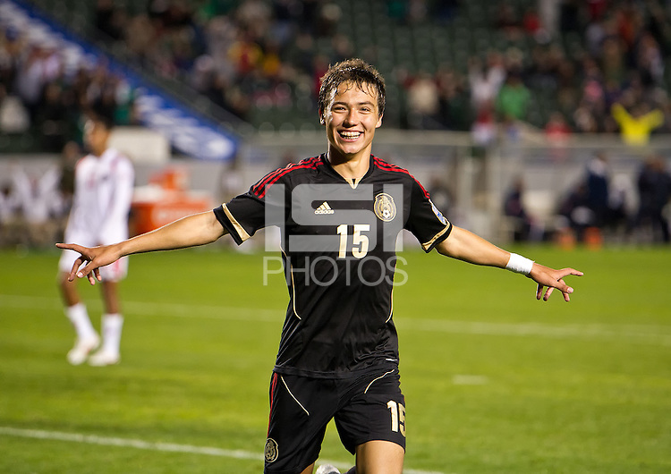 CARSON, CA - March 25, 2012: Eric Torres (15) of Mexico celebrating his game winning goal during the Mexico vs Panama match at the Home Depot Center in Carson, California. Final score Mexico 1, Panama 0.
