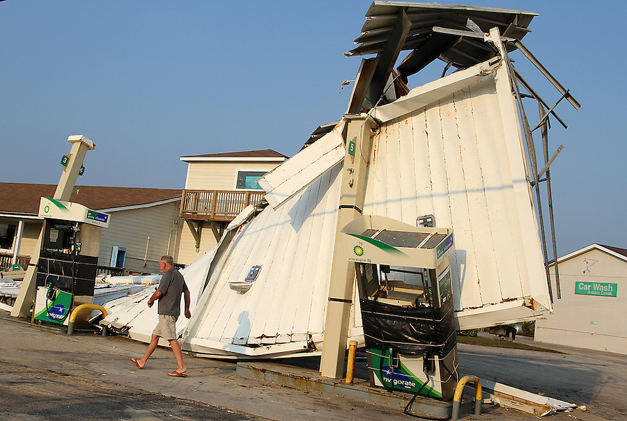 Buck Scott inspects damage to his gas station in Avon, NC, along the Outer Banks following Hurricane Irene on Monday, Aug. 29, 2011. Photo by Ted Richardson