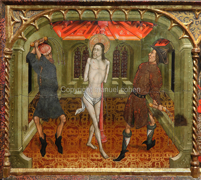 The Flagellation, showing Christ, prior to his crucifixion, tied to a column and being whipped by 2 servants of Pontius Pilate, from the main altarpiece by Jaume Cicera and Guillem Talarn, 1450-51, in the Church of Sant Miquel, or Church of St Michael, churches of Sant Pere (St Peter), Terrassa, Catalonia, Spain. The church itself is a simple stone structure of Greek cross plan with 8 reused visigothic columns supporting arches around the central gallery. The Sant Pere complex consists of 2 churches (Sant Pere and Santa Maria) and a baptistery (Sant Miquel, following the Byzantine model. They were built close to the site of old Egara to be the seat of the Egara diocese, founded c. 450 AD. The buildings were completed in the 11th and 12th centuries in Romanesque style, on the site of pre-Romanesque buildings from the Visigothic period. Picture by Manuel Cohen