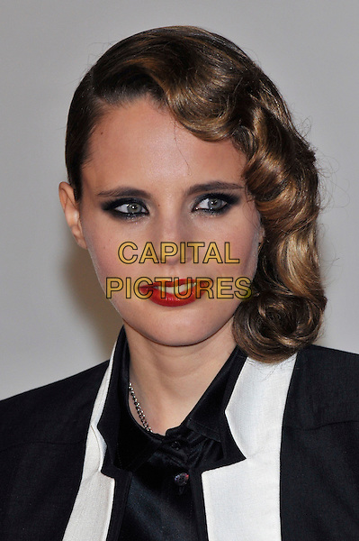 Anna Calvi.The Brit Awards 2012 arrivals, O2 Greenwich, London, England..21st February 2012.Brits headshot portrait black white red lipstick eyeliner make-up beauty .CAP/PL.©Phil Loftus/Capital Pictures.