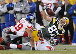 Green Bay Packers receiver Jordy Nelson fumbles the ball near New York Giants Michael Boley, left, and Aaron Ross during the second quarter of the game at Lambeau Field in Green Bay, Wis., on Dec. 26, 2010.  The Giants scored a touchdown on the ensuing posession.
