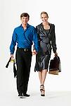 Young couple walking, carrying shopping bags