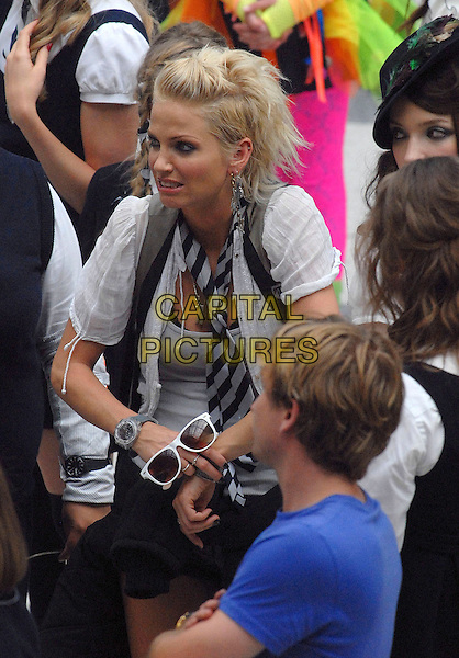 "SARAH HARDING .Filming scenes for ""St Trinian's: The Legend of Fritton's Gold"" at Liverpool Street Station, London, England, UK, .August 16th 2009..half length film set filmset costume school uniform white shirt tie grey gray watch girls aloud.CAP/IA.©Ian Allis/Capital Pictures"