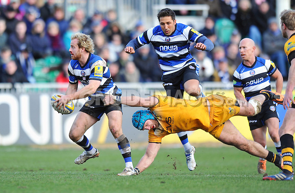 Nick Abendanon evades the tackle of James Haskell. Aviva Premiership match, between Bath Rugby and London Wasps on February 22, 2014 at the Recreation Ground in Bath, England. Photo by: Patrick Khachfe / Onside Images