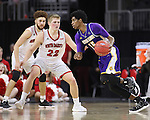SIOUX FALLS, SD: MARCH 4: Dalan Ancrum #15 of Western Illinois drives on Tyler Peterson #22 of South Dakota on March 4, 2017 during the Summit League Basketball Championship at the Denny Sanford Premier Center in Sioux Falls, SD. (Photo by Dick Carlson/Inertia)