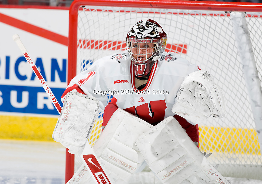 MADISON, WI - NOVEMBER 2: Goalie Krista Tatum #1 of the Wisconsin Badgers women's hockey team practices during warmups prior to the game against the Minnesota Golden Gophers at the Kohl Center on November 2, 2007, in Madison, Wisconsin. The Badgers beat the Golden Gophers 3-0. (Photo by David Stluka)
