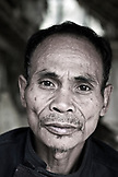 PHILIPPINES, Palawan, Barangay region, portrait of Batak Chief in his home in Kalakwasan Village
