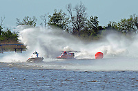Frame 9: Terry Rinker (#10) and Chris Fairchild (#62) race up the back stright to turn 2 where Rinker's boat rolls over a wake, noses in and flips.   (Formula 1/F1/Champ class)