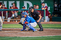 Ramon Rodriguez (3) of the Ogden Raptors on defense as umpire Rene Gallegos handles the calls behind the plate during a game between the Ogden Raptors and the Idaho Falls Chukars at Lindquist Field on August 29, 2018 in Ogden, Utah. Idaho Falls defeated Ogden 15-6. (Stephen Smith/Four Seam Images)