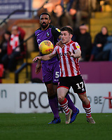 Lincoln City's Shay McCartan vies for possession with Port Vale's Leon Legge<br /> <br /> Photographer Chris Vaughan/CameraSport<br /> <br /> The EFL Sky Bet League Two - Lincoln City v Port Vale - Tuesday 1st January 2019 - Sincil Bank - Lincoln<br /> <br /> World Copyright © 2019 CameraSport. All rights reserved. 43 Linden Ave. Countesthorpe. Leicester. England. LE8 5PG - Tel: +44 (0) 116 277 4147 - admin@camerasport.com - www.camerasport.com