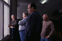 Men who are part of a lawsuit wait for the judge to arrive and the court to come to order.152 frustrated citizens banded together in a lawsuit in an effort to halt the assault on their air.  <br /> In Boone country, Elk Run Coal Co was issued 72 environmental citations and notices of violations four years for polluting air in the town of Sylvester's fouling the nearby Coal River.
