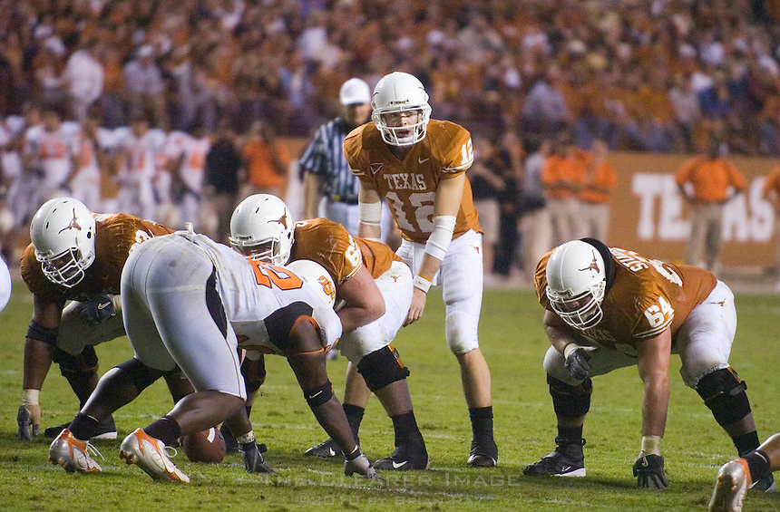 04 November 2006: Texas quarterback Colt McCoy (#12) audibles at the line of scrimmage during the Longhorns 36-10 victory over the Oklahoma State University Cowboys at Darrel K Royal Memorial Stadium in Austin, Texas.