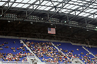 Fans sit and wait as the lights failed just prior to a Major League Soccer (MLS) match between the New York Red Bulls  and CD Chivas USA at Red Bull Arena in Harrison, NJ, on May 15, 2011.