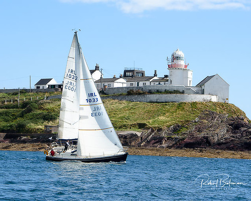 Loch Greine, owned by Tom Donal and Declan O'Mahony sailing past Roches Point Lighthouse
