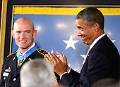 United States President Barack Obama applauds after awarding the Medal of Honor for conspicuous gallantry to Staff Sergeant Ty M. Carter, U.S. Army, during a ceremony in the East Room of the White House in Washington, D.C. on Monday, August 26, 2013.  Staff Sergeant Carter is being honored for courageous actions while serving as a cavalry scout with Bravo Troop, 3rd Squadron, 61st Cavalry Regiment, 4th Brigade Combat Team, 4th Infantry Division, during combat operations in Kamdesh District, Nuristan Province, Afghanistan on October 3, 2009. Staff Sergeant Carter is the fifth living veteran to be awarded the Medal of Honor for actions in Iraq or Afghanistan.  <br /> Credit: Ron Sachs / CNP