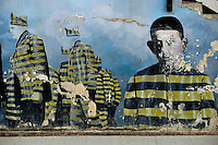 Mural of former prisoners at Ushuaia Jail, painted on the steps of the Post Office - Ushuaia Street Scenes