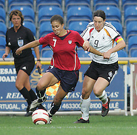 MAR 15, 2006: Faro, Portugal:  USWNT midfielder (7) Shannon Boxx tries to cross the ball under pressure from German forward (9) Birgit Prinz in the finals of the Algarve Cup in Faro, Portugal.