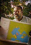 Bram Wariensi of Lobo Village looks over a map of no-take zones designated by his and other villages in Triton Bay, West Papua.