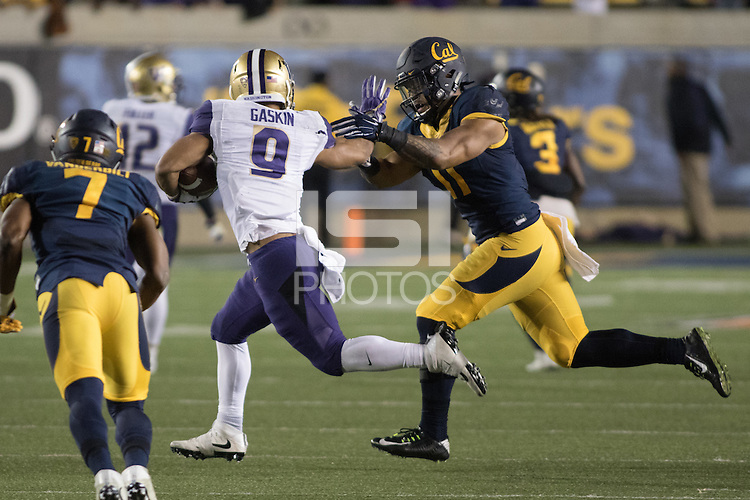 BERKELEY, CA - November 5, 2016: Cal's (11) Hamilton Anoa'i attempts to tackle Washington's (9) Myles Gaskin at California Memorial Stadium.