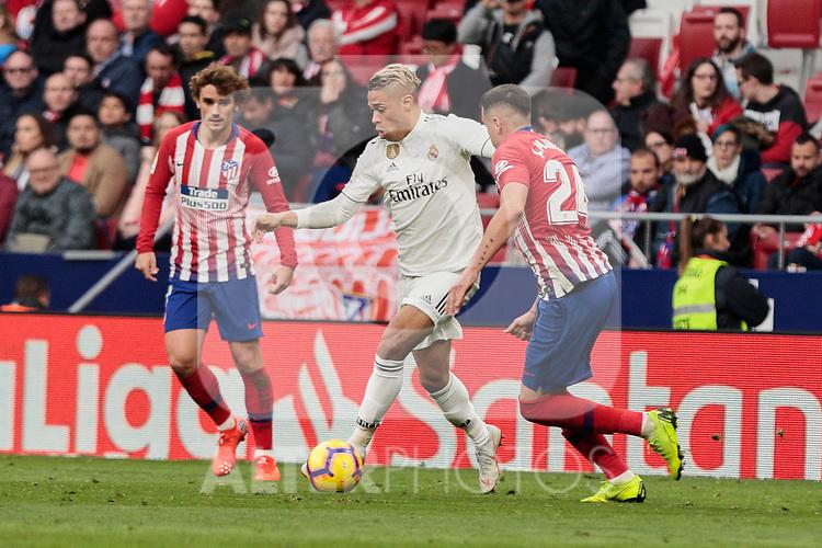 Atletico de Madrid's Jose Maria Gimenez and Real Madrid's Mariano Diaz during La Liga match between Atletico de Madrid and Real Madrid at Wanda Metropolitano Stadium in Madrid, Spain. February 09, 2019. (ALTERPHOTOS/A. Perez Meca)