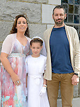 Abbie Tighe who received her first holy communion in Duleek church pictured with parents Keith and Lyndsey. Photo:Colin Bell/pressphotos.ie