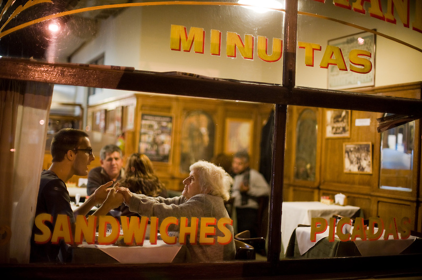 Locals greet each other in the hallowed seats of Bar Britanico in Buenos Aires' storied San Telmo neighborhood. Frequented by British war veterans and railroad workers in the mid-20th century, the bar took on the name of its patrons. (Kevin Moloney for the New York Times)