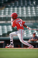 Philadelphia Phillies Julio Francisco (17) follows through on a swing during a Florida Instructional League game against the Baltimore Orioles on October 4, 2018 at Ed Smith Stadium in Sarasota, Florida.  (Mike Janes/Four Seam Images)