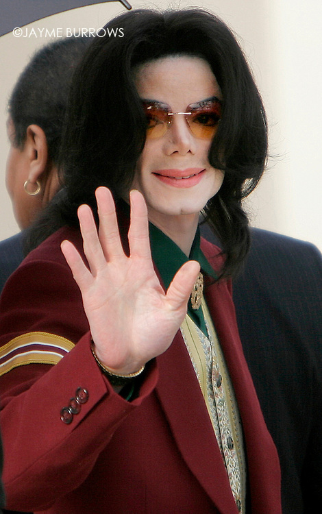 Michael Jackson enters the courtroom on the 14th day of his child molestation trial in Santa Maria, Calif on Monday, March 17, 2005. ..