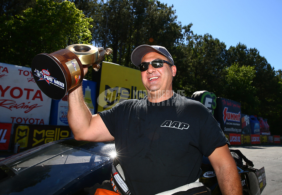 May 7, 2017; Commerce, GA, USA; NHRA pro mod driver Mike Castellana celebrates after winning the Southern Nationals at Atlanta Dragway. Mandatory Credit: Mark J. Rebilas-USA TODAY Sports