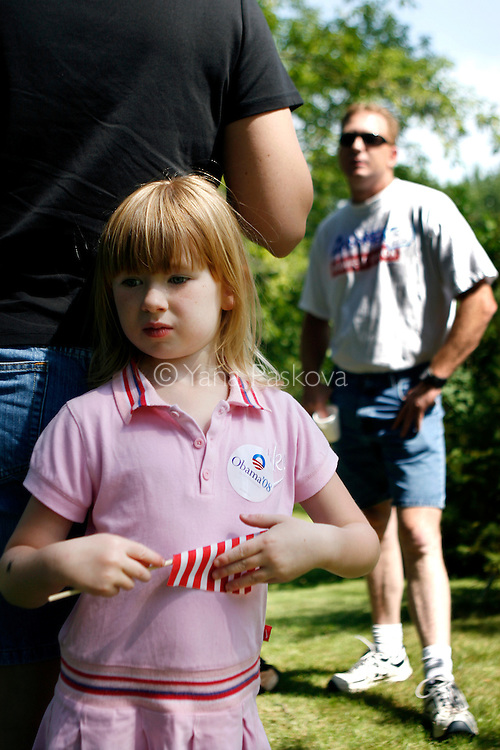A little girl runs listens to Democratic Presidential hopeful Barack Obama (D-IL) campaign in Manchester, IA, on July 14, 2007.