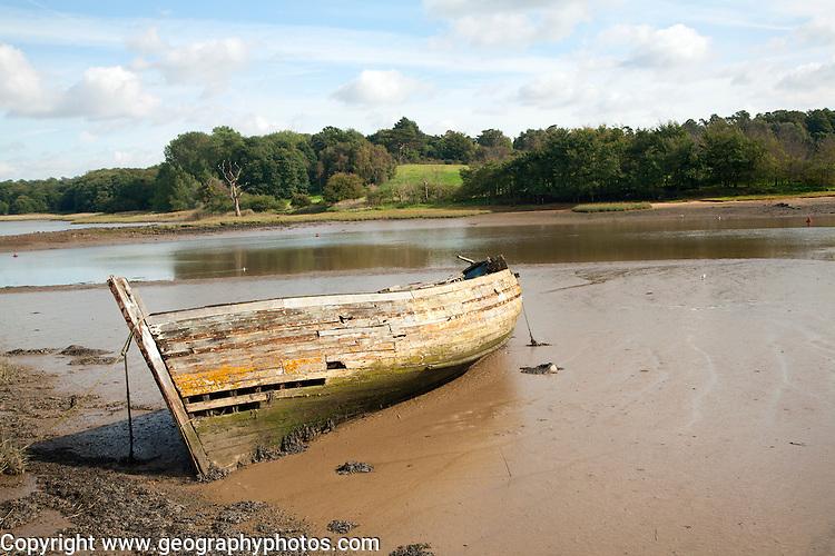 Old abandoned boat on River Deben at low tide, Melton, Suffolk, England