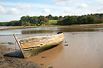 Old abandoned boat on River Deben at low tide, Melton, Suffolk, England
