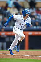 Jake Cronenworth (1) of the Durham Bulls hustles down the first base line against the Gwinnett Braves at Durham Bulls Athletic Park on April 20, 2019 in Durham, North Carolina. The Bulls defeated the Braves 11-3 in game one of a double-header. (Brian Westerholt/Four Seam Images)