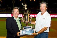 Carolina League President John Hopkins (left) presents Winston-Salem Dash owner Billy Prim (right) with the trophy following the 2012 California-Carolina League All-Star Game at BB&T Ballpark on June 19, 2012 in Winston-Salem, North Carolina.  The Carolina League defeated the California League 9-1.  (Brian Westerholt/Four Seam Images)