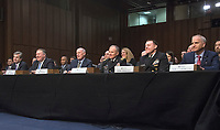From left to right: Federal Bureau of Investigation (FBI) Director Christopher Wray,  Central Intelligence Agency (CIA) Director Mike Pompeo, Director of National Intelligence (DNI) Dan Coats, Defense Intelligence Agency (DIA) Director Lieutenant General Robert P. Ashley, Jr., United States Army, National Security Agency (NSA) Director Admiral Michael S. Rogers, United States Navy, and National Geospatial-Intelligence Agency (NGA) Director Robert Cardillo, appear together as they testify before the United States Senate Committee on Intelligence during a hearing to examine worldwide threats on Capitol Hill in Washington, DC on Tuesday, February 13, 2018<br /> Credit: Ron Sachs / CNP /MediaPunch