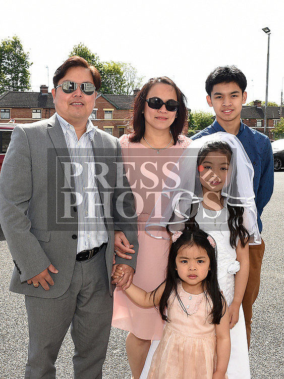 Chloe Abarico from St Brigids school who received her Fiirst Holy Communion in Our Lady of Lourdes church pictured with her family. Photo:Colin Bell/pressphotos.ie